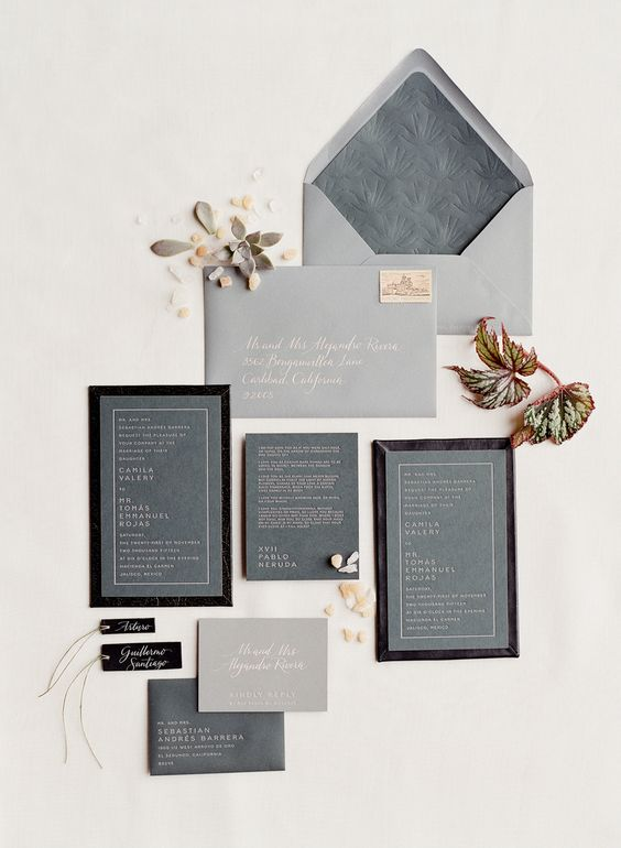 a modern grey and black invitation suite with pressed letters and frames for a minimalist wedding in grey shades