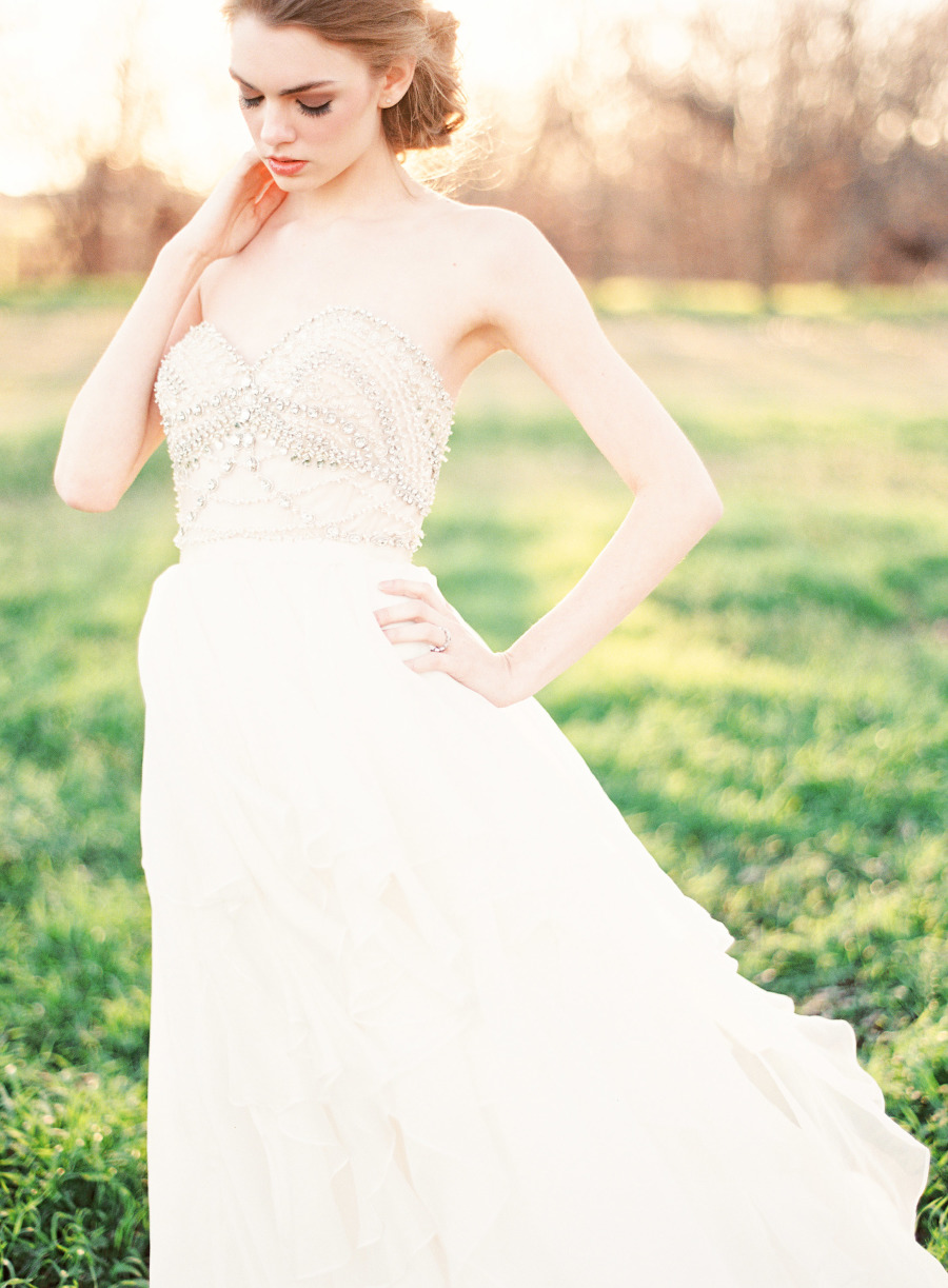 intricate yet feminine, the beaded bodice of this ballgown sparkles in the most romantic way possible