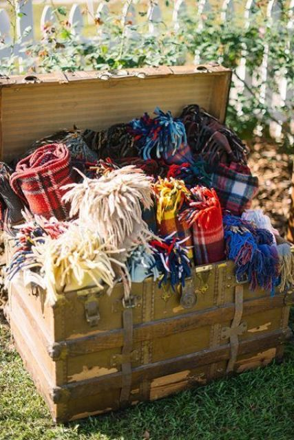 offer your guests to snuggle up into cozy plaid pashminas and scarves to feel warm during an outdoor ceremony