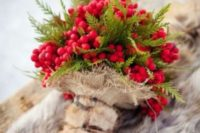 23 a bouquet made of berries and fern with burlap and faux fur handle looks wow