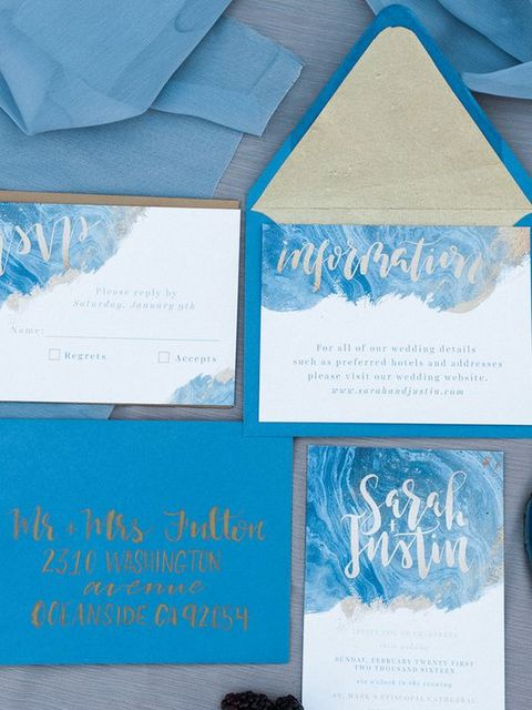 ice blue wedding invitation suite with swirly frosty prints and calligraphy