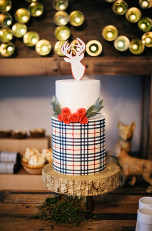 a reindeer-topped cake features a festive plaid pattern set off with red wafer-paper rosebuds