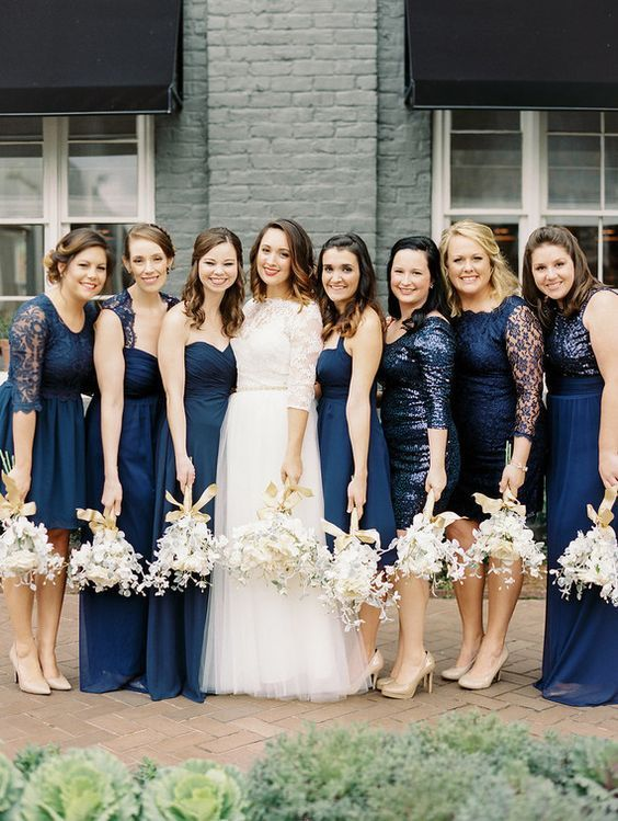 mismatched midnight blue dresses of various lengths and looks