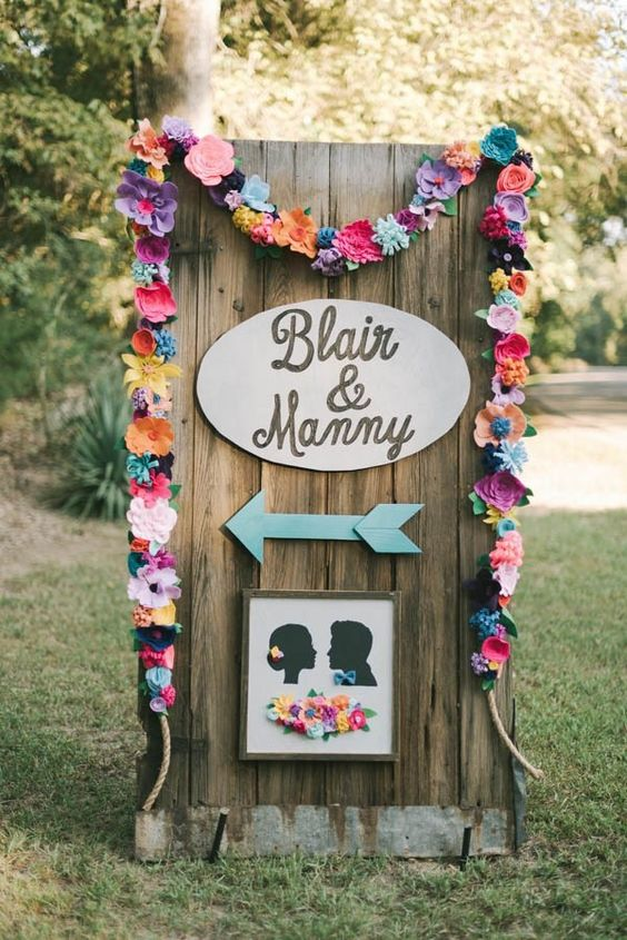 a colorful paper flower garland for decorating various spaces and parts of your wedding venue