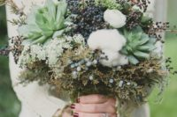 25 a wintery bouquet with privet berries, cotton, succulents and textural greenery