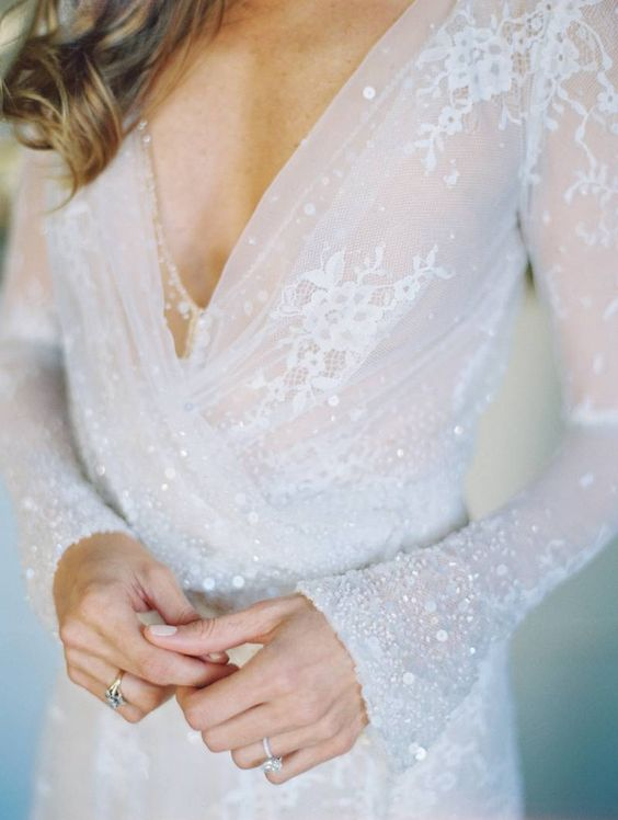 stunning plunging neckline wedding dress with lace and a touch of sparkle looks wow