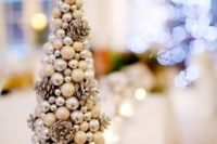 26 a Christmas tree made of small pinecones, silver beads and pearls looks very glam and can be easily DIYed