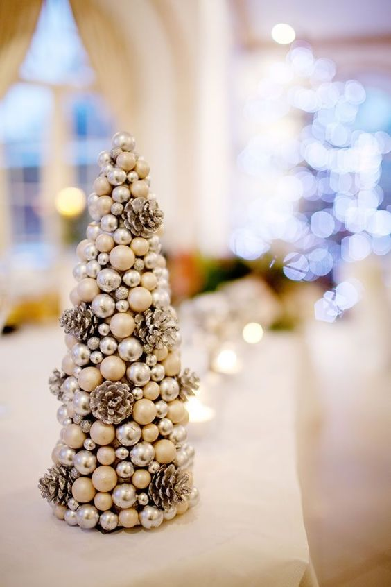 a Christmas tree made of small pinecones, silver beads and pearls looks very glam and can be easily DIYed