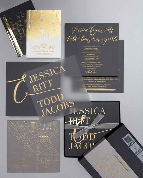 a matte black and sheer wedding invitation set with gold letters and gold leaf decor for a bold statement
