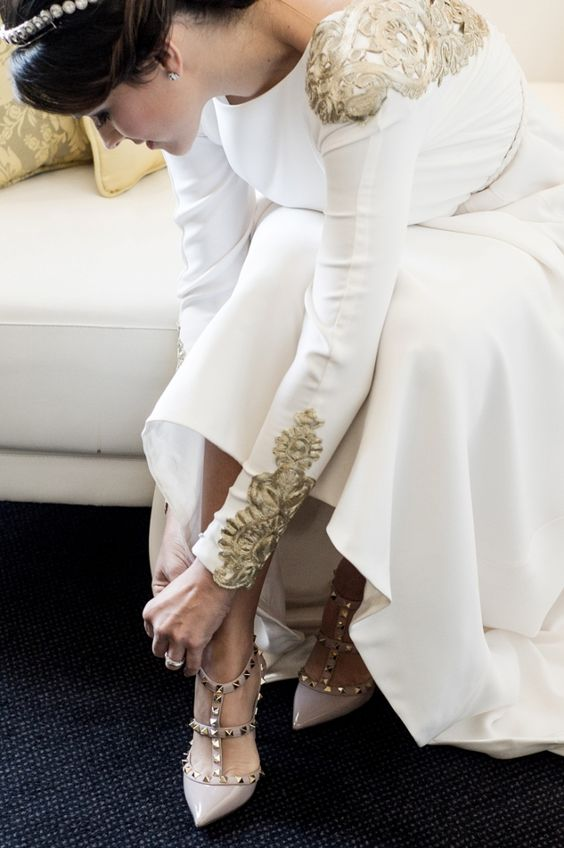 neutral spiked Valentino heels with pointed toes and ankle straps can be worn after the wedding
