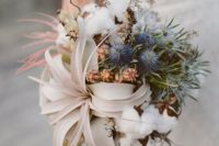 27 an organic wedding bouquet with air plants, blue thistles, and cotton