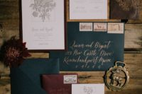 28 a vintage-inspired winter wedding invitation suite in burgundy, emerald and gold, which are traditional for Christmas