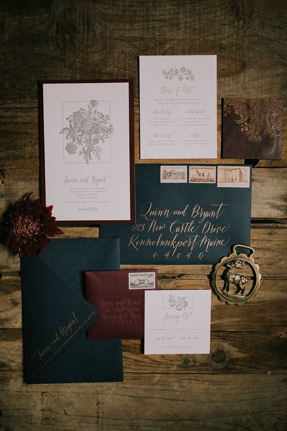 a vintage inspired winter wedding invitation suite in burgundy, emerald and gold, which are traditional for Christmas