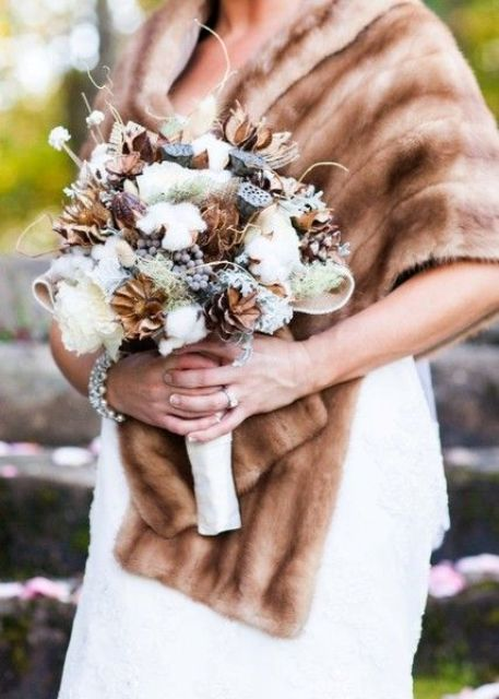 brown and white wedding bouquet with white roses, pinecones and cotton