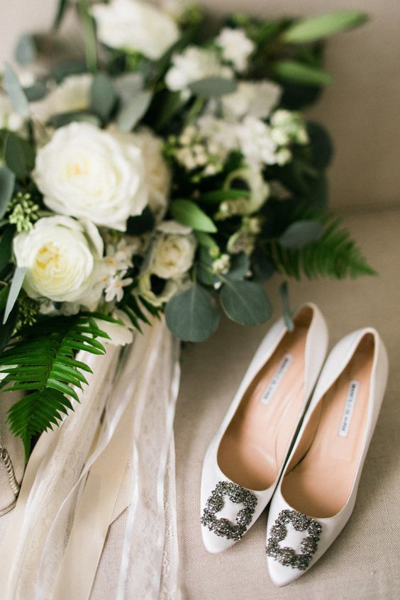 white Manolo Blahnick pumps look nowhere but boring and are a gorgeous idea for any bride