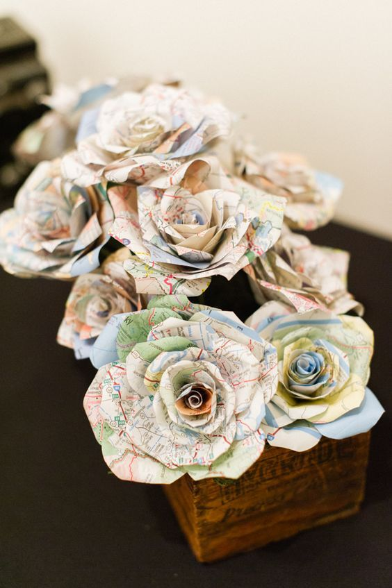 paper flowers of a map to decorate a travel-inspired wedding