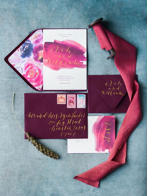 plum colored envelopes, pink and purple watercolor wedding invites with gold calligraphy