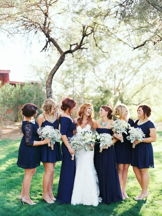 different midnight blue bridesmaids' gowns