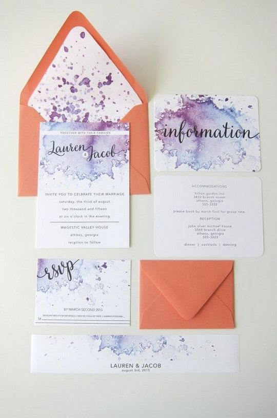 purple and blue watercolor wedding invites and orange envelopes for a modern colorful wedding