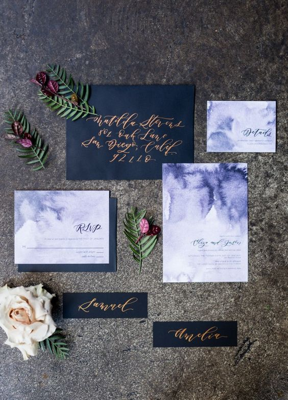 black envelopes and watercolor purple wedding invites with calligraphy for a dark colored wedding