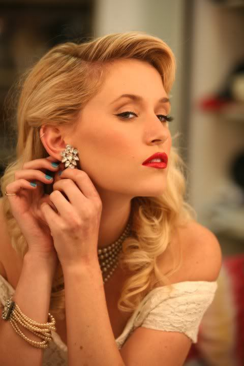 1940s glam makeup with a red lip, vintage waves and statement rhinestone earrings