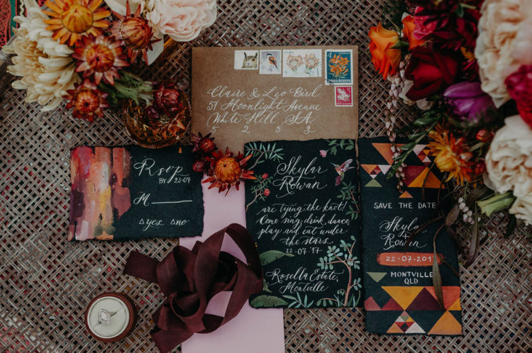 A bold stationery suite with colorful prints and tribal watercolor motifs
