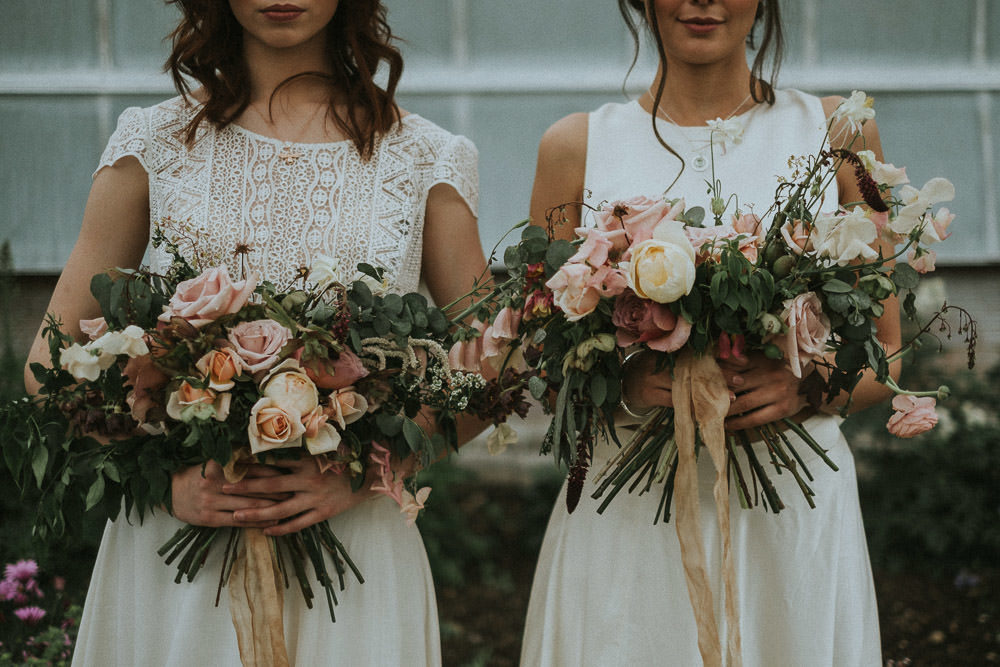 The bouquets were with pink, peachy, neutral blooms and much greenery and ocher ribbons
