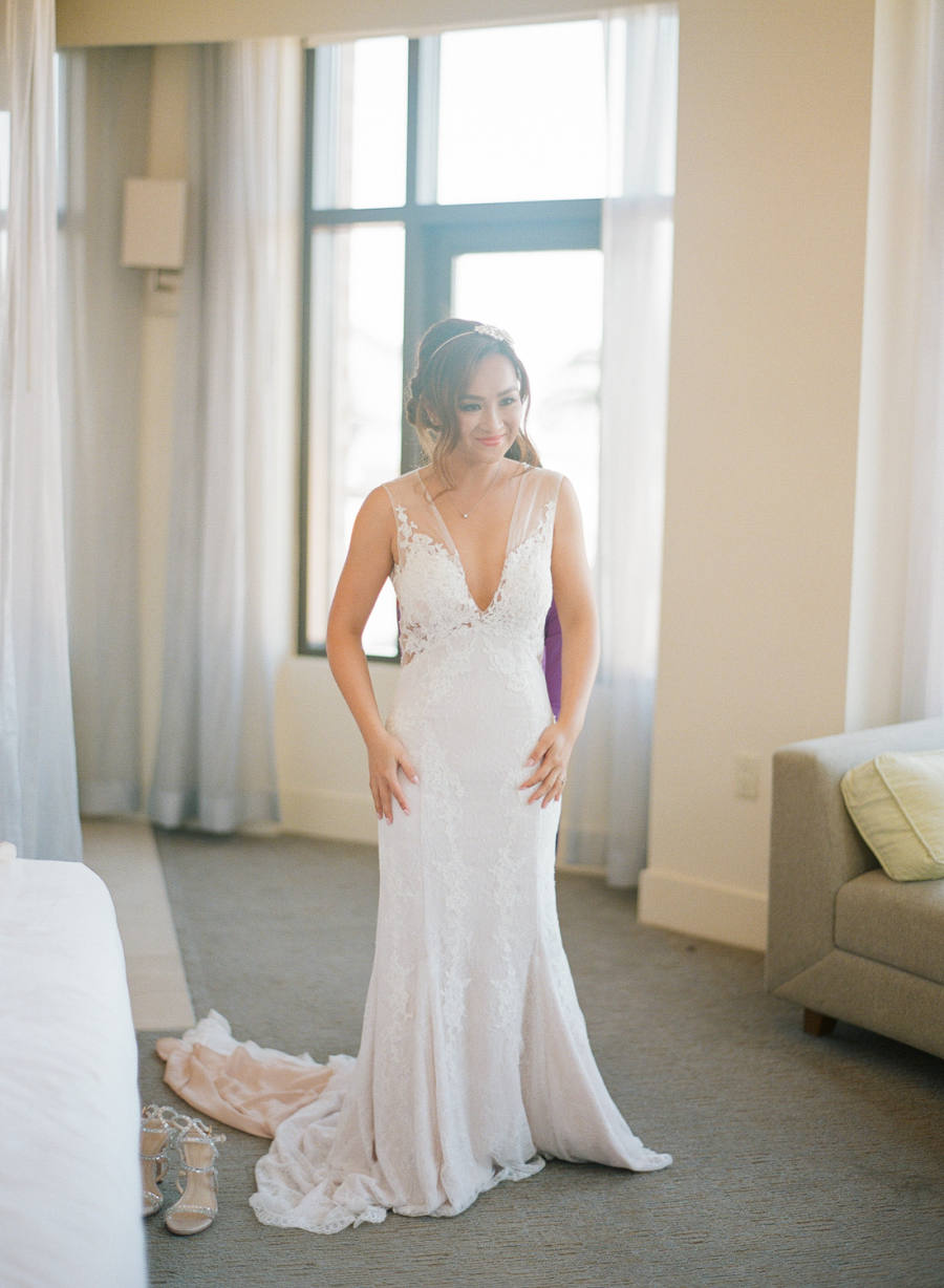 The bride was wearing a plunging neckline wedding dress with an illusion bodice, shoulders and back