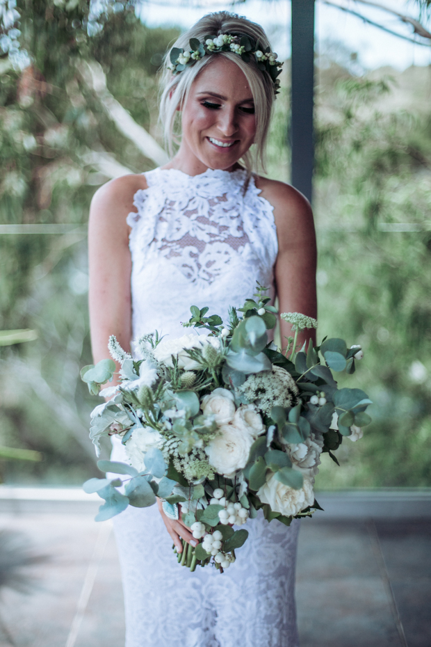 The bride was wearing  lace halter neckline wedding dress by Grace Loves Grace, her bouquet was neutral and with white blooms