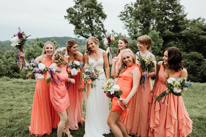 The bridesmaids were wearing mismatched coral dresses, each chose her own one to show off her style