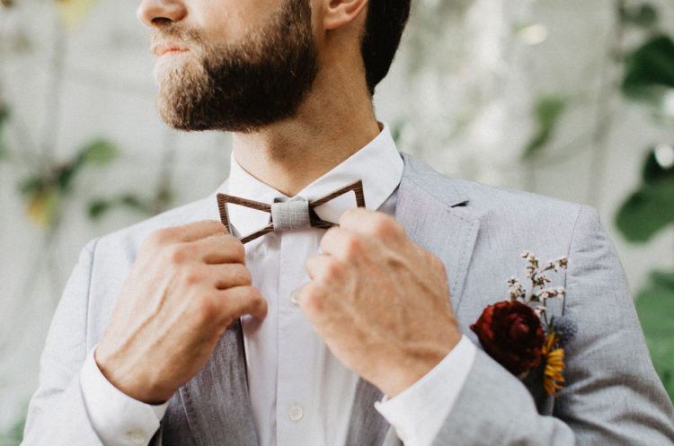 The groom was wearing a very cool bow tie, a light grey jacket and printed pants for a bold and unusual look