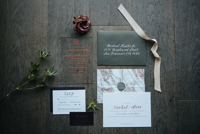 The wedding stationery was modern and bold, with black, white and copper and acrylic parts