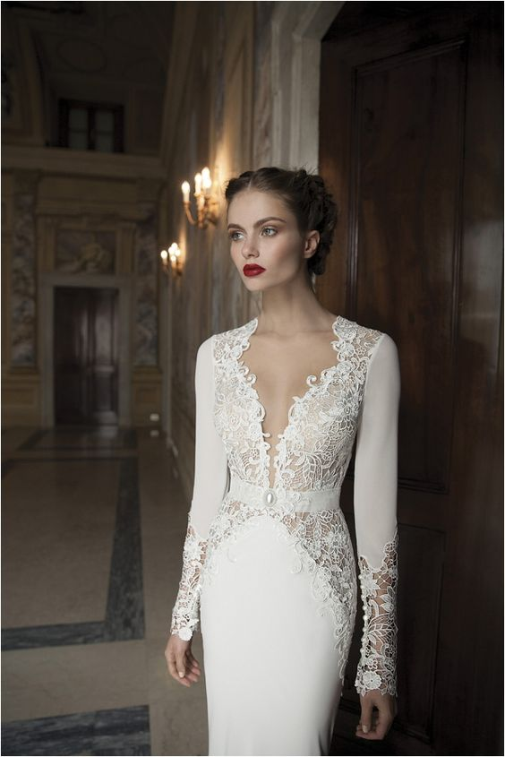 a chic plunging neckline wedding dress with lace inserts and long sleeves for a refined bride