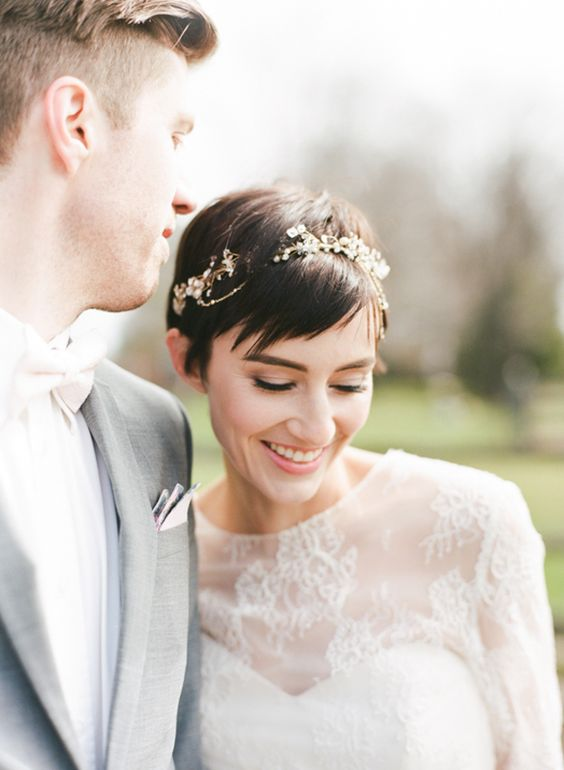 a cool short wedding hairstyle accessorized with a rhinestone and pearl headband for a glam look