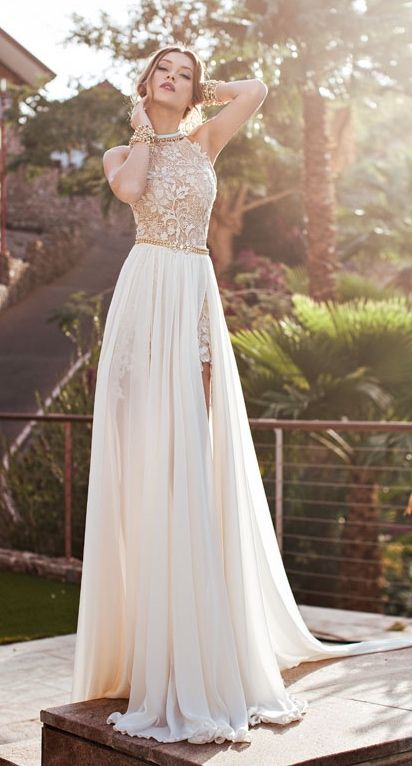 an ivory dress with a textural halter neckline bodice and an overskirt with slits can be transformed any time