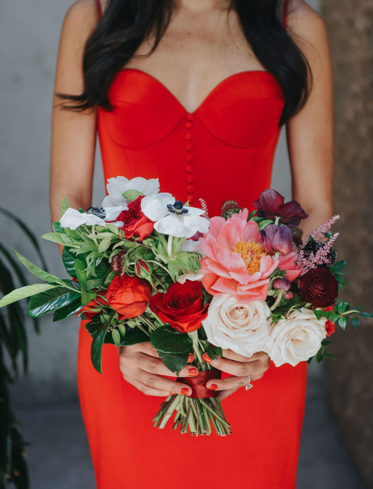 Her bouquet was done with pink, white, burgundy and red blooms