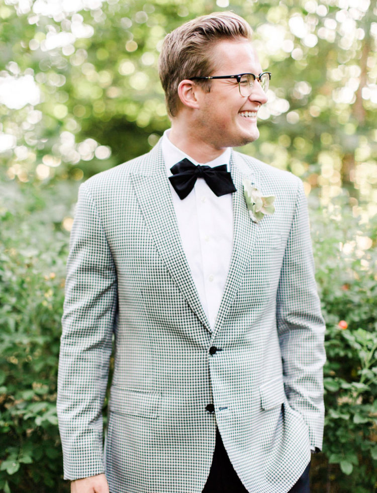 One groom was rocking a chic tuxedo with a checkerboard jacket, black pants and a black bow tie