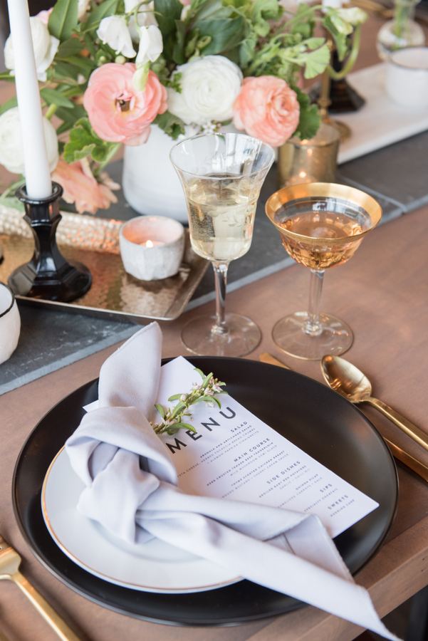 Some dramatic details were matte black plates, black candle holders and a graphite grey table runner