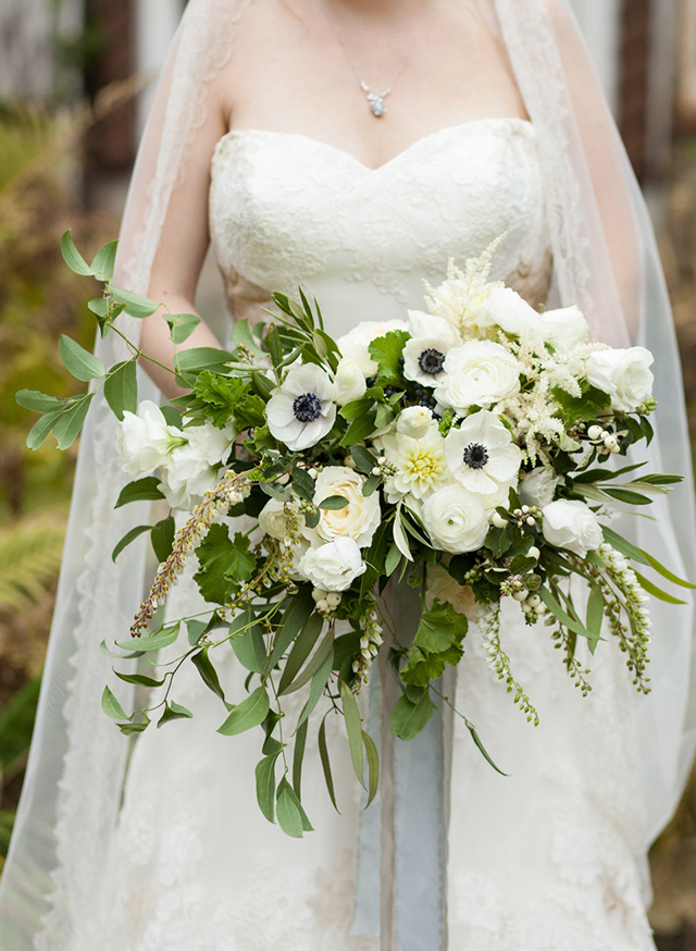 The bridal bouquet was done of white blooms and textural greenery as neutrals are classic