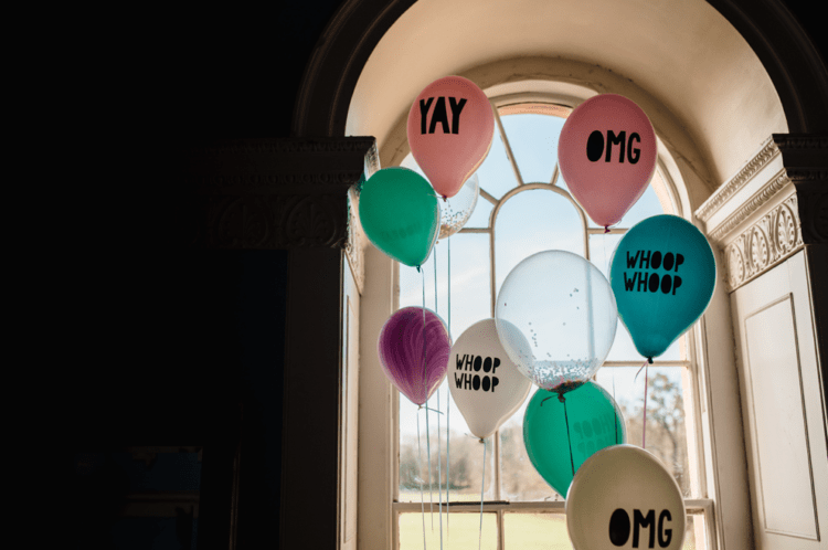 The couple chose to have colorful and printed balloons instead of flowers that can cost a lot
