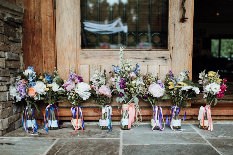 The wedding bouquets were also with coral, pink and blue blooms