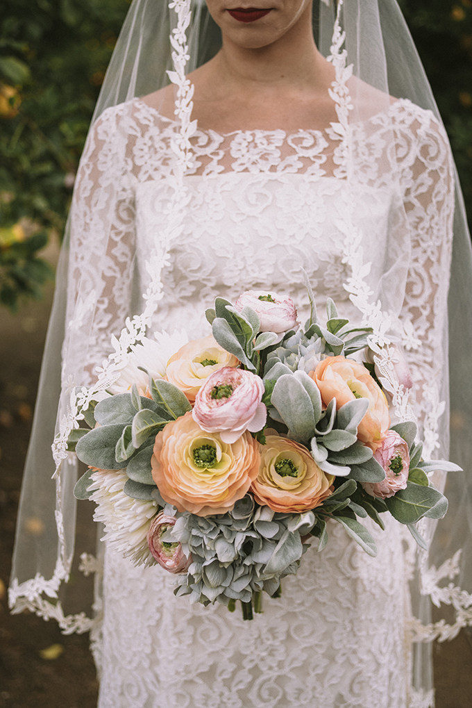 The wedding dress was a lace one with an illusion neckline, long sleeves and a matching veil