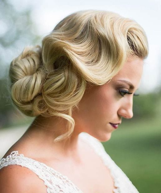 a gorgeous wavy vintage wedding updo is perfect for such a wedding