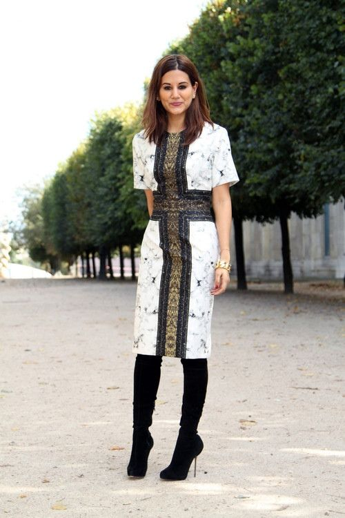 a gorgeous white printed knee dress with short sleeves, a large gold and black cross and black suede boots