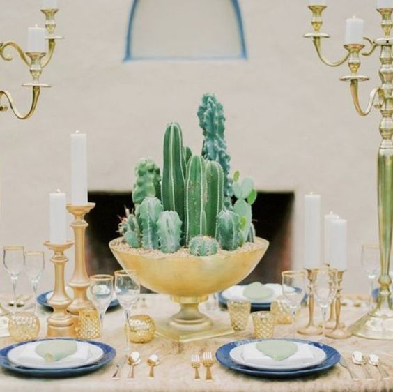 a tall gilded bowl with cacti is a chic idea for a desert inspired wedding