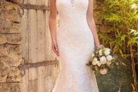 03 a trumpet lace halter neckline wedding dress with an illusion sweteheart neckline and a train