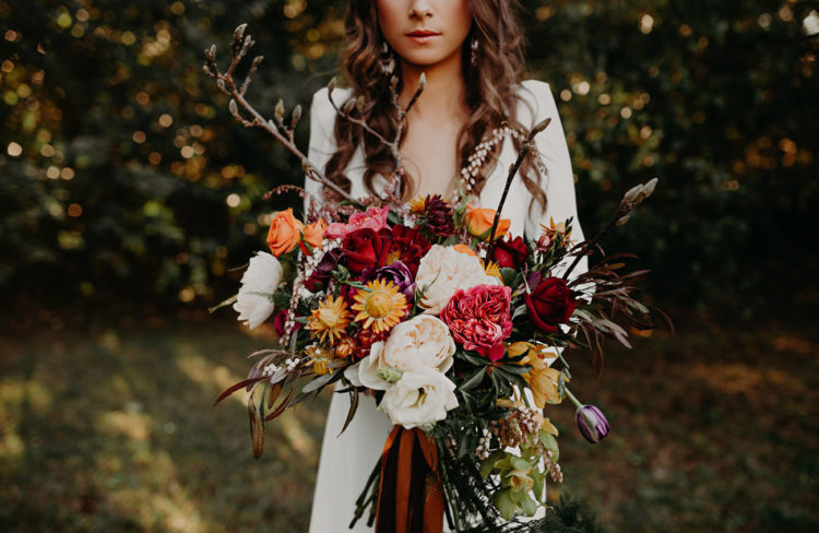 Her wildflower bouquet was full of willow, peonies and bold roses