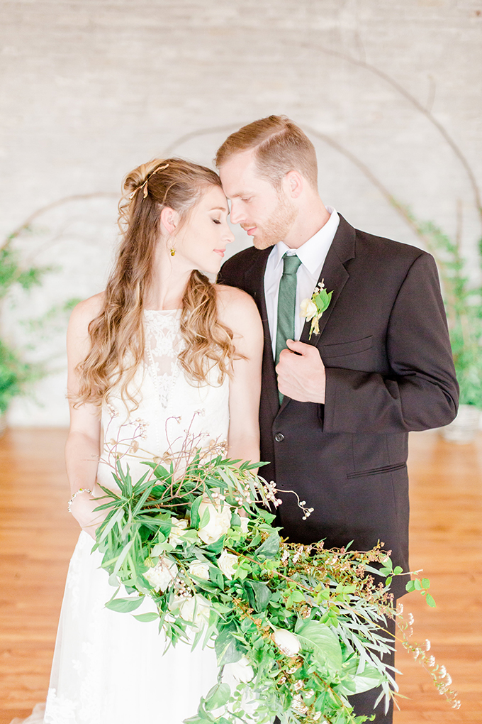 The gorgeous cascading greenery bouquet was textural and with some refreshing white blooms
