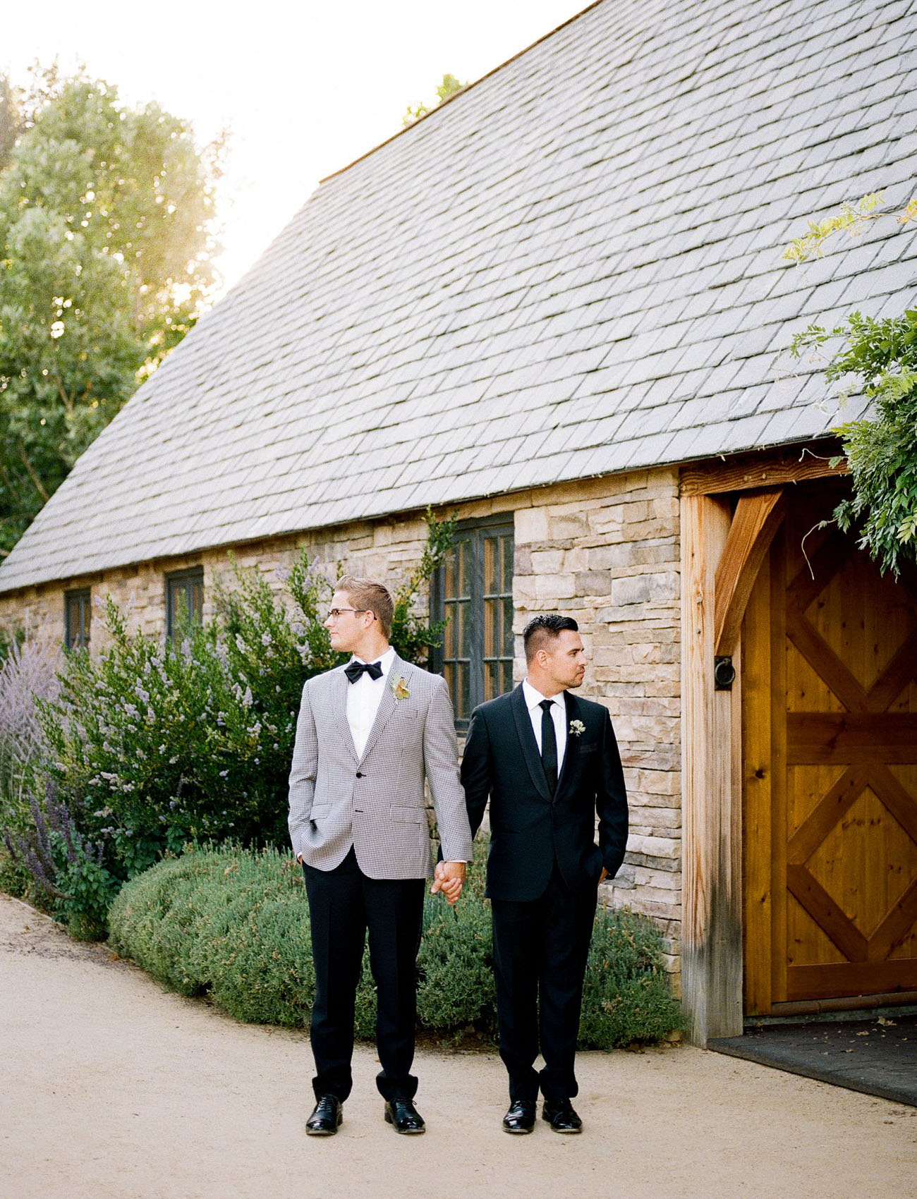 The second groom was wearing a classic black tux with a tie