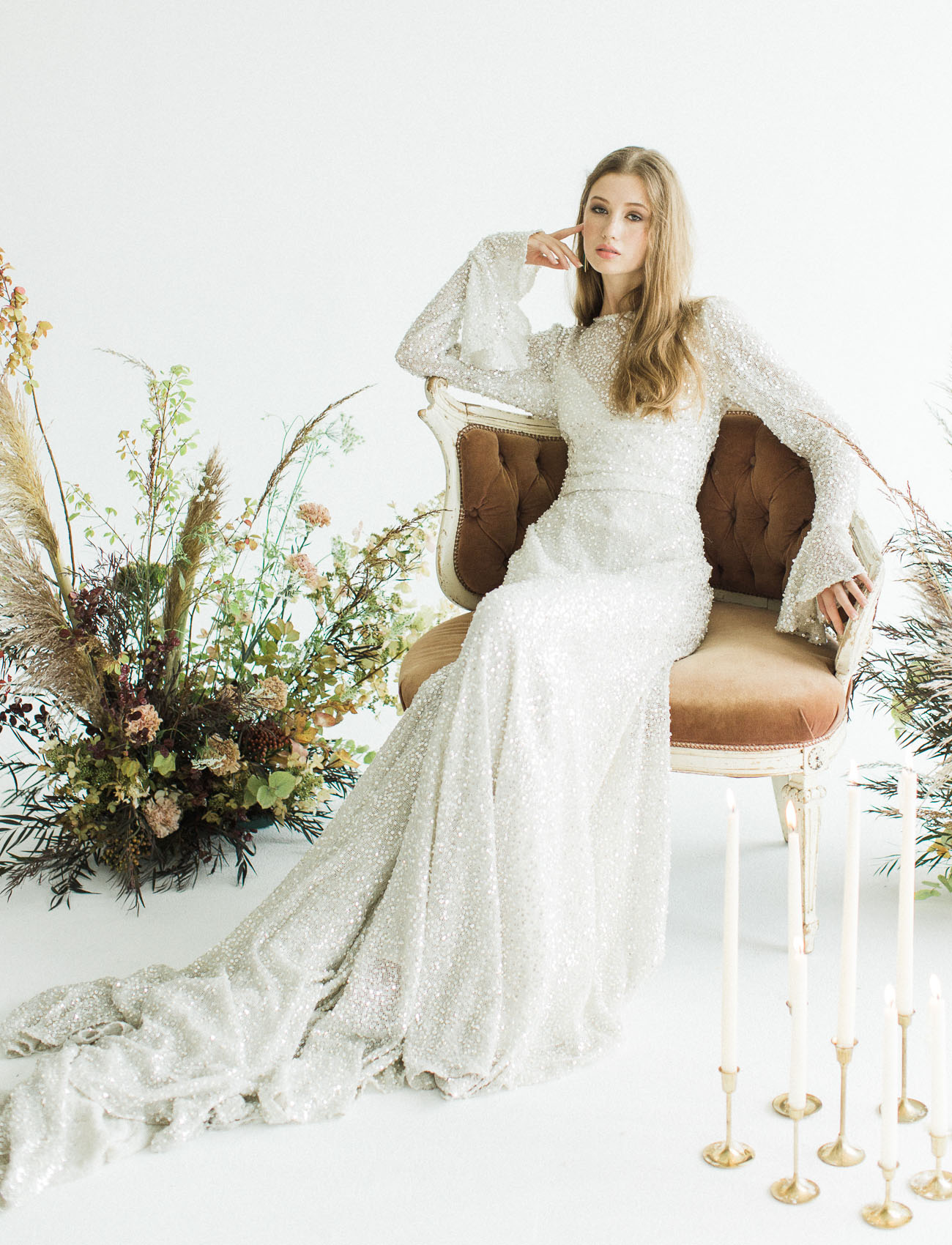 The second wedding dress was a beaded one with bell sleeves and a train and an illution neckline, so beautiful